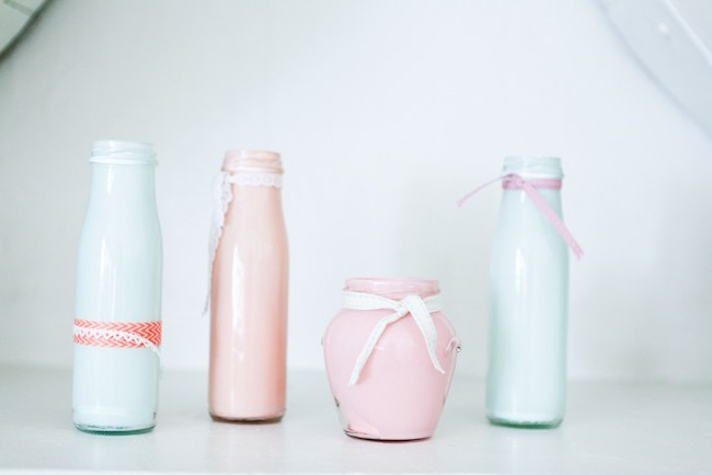 Pink, peach and powder blue DIY painted milk bottles - wedding decor  :: Pretty Pastel and Powder Blue DIY South African Wedding captured by Nadine Aucamp Photography :: Published on Confetti Daydreams Wedding Blog