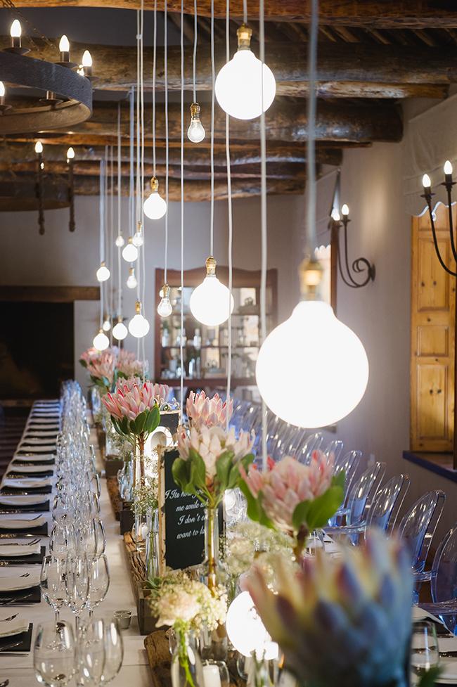Protea Reception Table Decor // Vintage Elegance Neutral South African Wedding //Lauren Kriedemann photography // via www.ConfettiDaydreams.com //