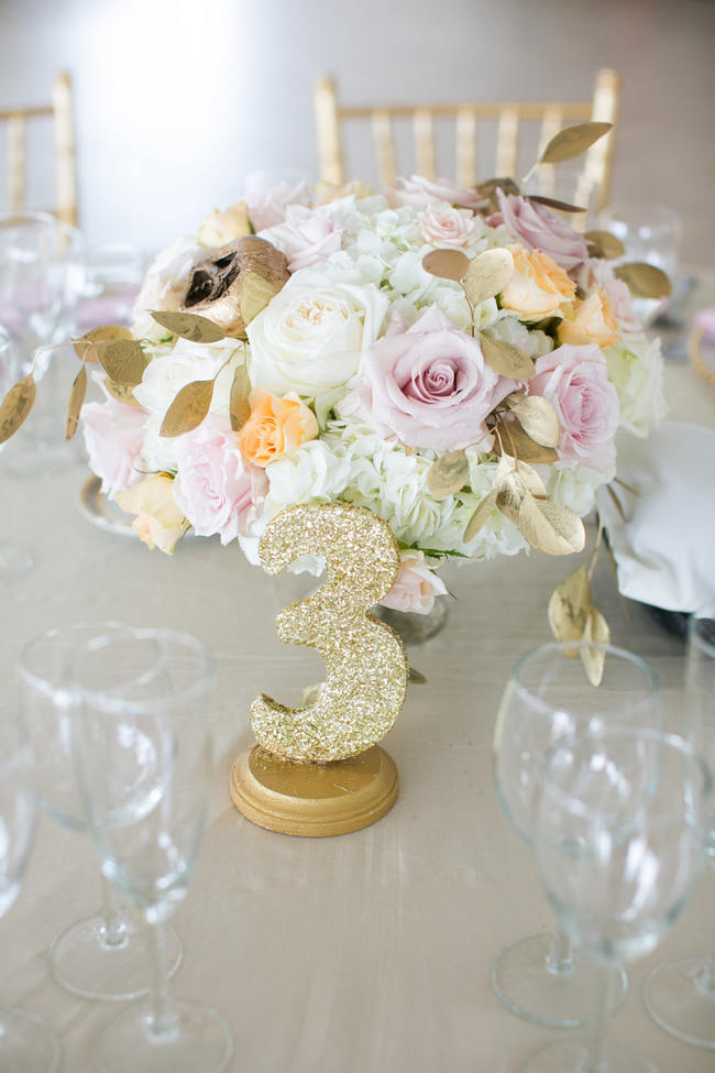 Glitter Table Number and Floral Arrangement // Beautiful Rustic Elegance Wedding in Blush Cream Gold // Carly Fuller Photography // Click for more details on www.ConfettiDaydreams.com