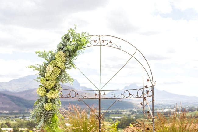 Green Organic Floral Wedding arch // Franschhoek Wedding // Photography by Claire Nicola