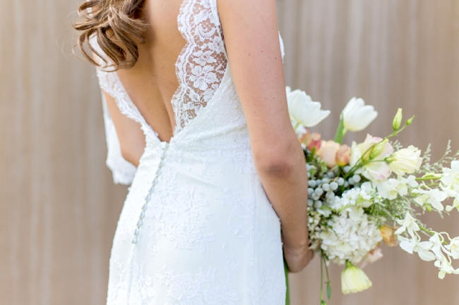 Lace trimmed, open back wedding dress // Franschhoek Wedding // Photography by Claire Nicola