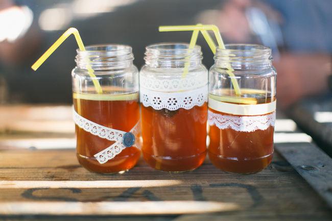 Mason jars with ribbon and yellow straws //  Beautiful Gray and Yellow Rustic Winter Wedding Reception Decor / Jenni Elizabeth Photography