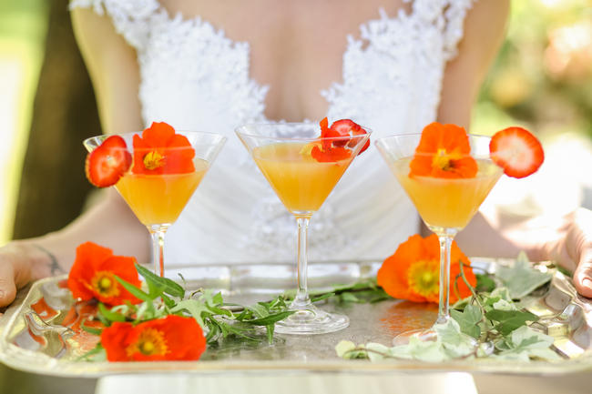 Peach martinis served on silver tray with peach flowers / // Nikki Meyer Photography
