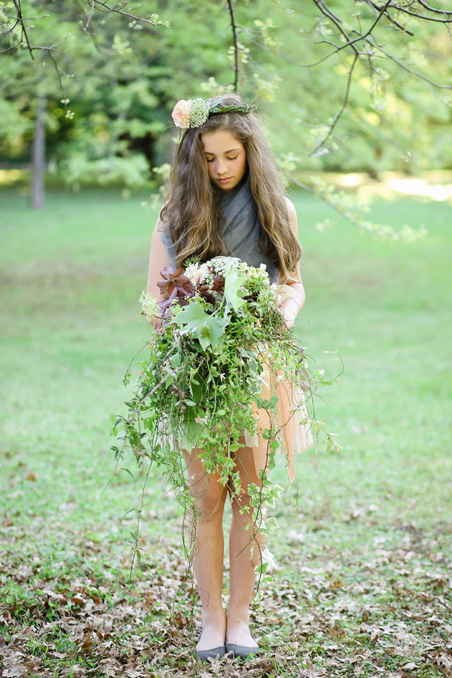 A rustic brown and green cascade fall wedding bouquet using steams and leaves for a Rustic Garden Picnic Wedding // Nikki Meyer Photography