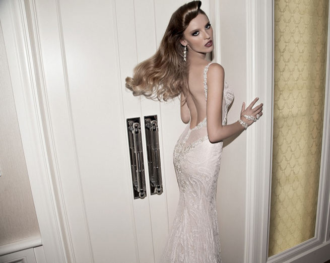 Galia Lahav's glittering and oh-so-glam Norma gown is knitted from stretch ivory lace. Rich in lace fabric, the dress is layered over shimmering net and nude lycra. The back of the dress is bare with a glittering sheer plunging detail.
