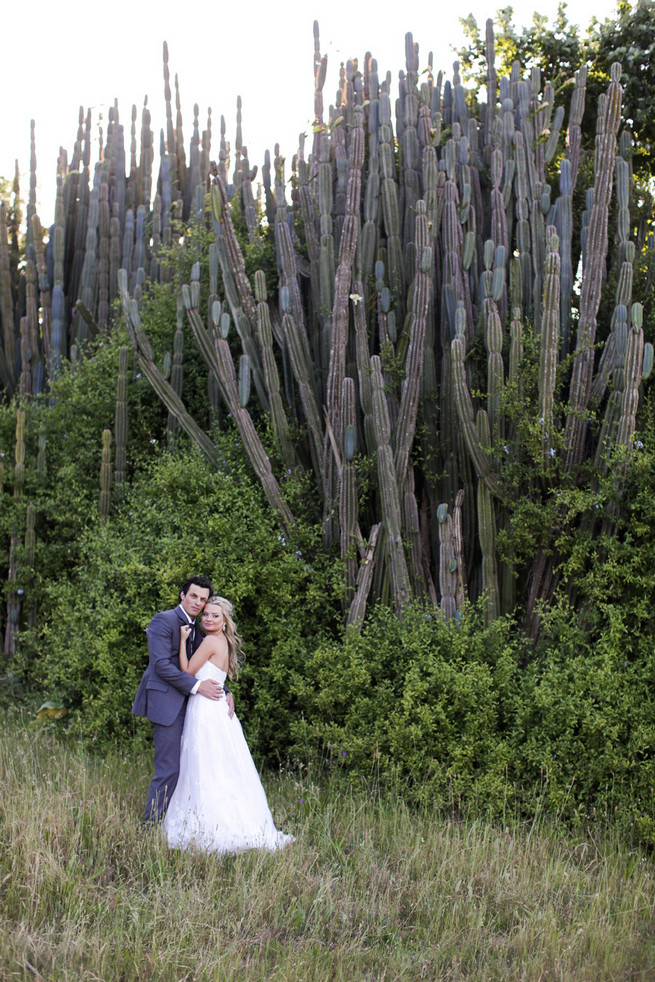 Groom in grey suit with grey tie. Green White Rustic South African Wedding // Justin Davis Photography