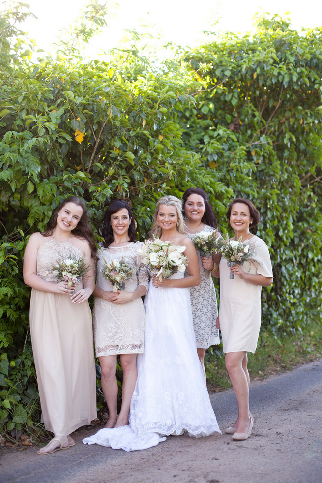 Taupe mix and match bridesmaids with green, white brown bouquets.  Green White Rustic South African Wedding // Justin Davis Photography