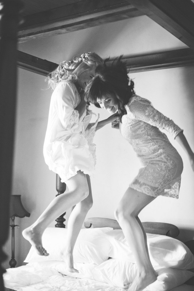Bridesmaids jumping on bed . Green White Rustic South African Wedding // Justin Davis Photography