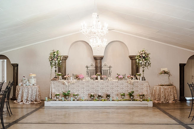 Spectacular arrangements of blooms all around the sweethear bridal table. Blush Pink and Powder Blue Spring Wedding // D'amor Photography