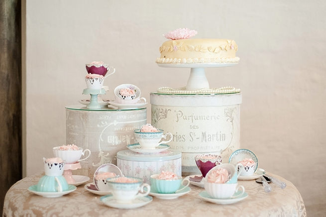 Whimsical cake table in pastel shades with teacups and goods baked by brides mom. Lazer cut Mr and Mrs Signs. Blush Pink and Powder Blue Spring Wedding // D'amor Photography