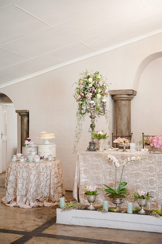 Blush and pink wedding flowers in silver urns and vases on wedding reception tables: hydrangea, pink and cream roses, lisanthius and leatherleaf ferns . So pretty for a spring wedding // D'amor Photography