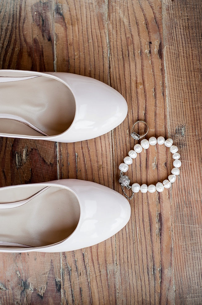 White ballet pump style wedding shoes are so pretty!
