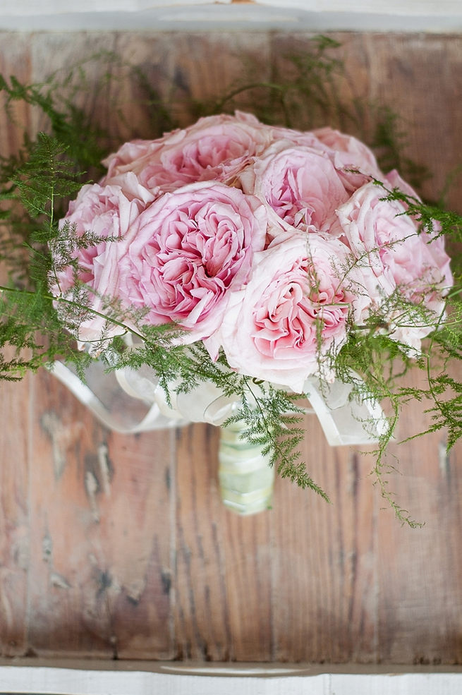 Wedding bouquet of baby pink peonies and leatherleaf ferns // D'amor Photography