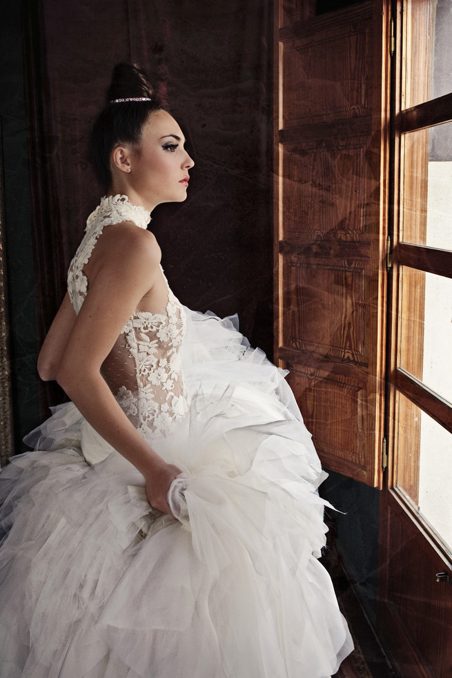 Dreamy wedding dress with layered tulle, lace front and open back. Ramon Herrerías Wedding Dresses