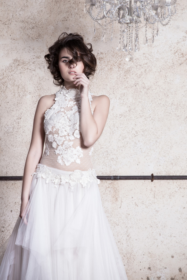 Lace backed wedding dress with flower embroidered on sheer fabrice . Ramon Herrerías Wedding Dresses