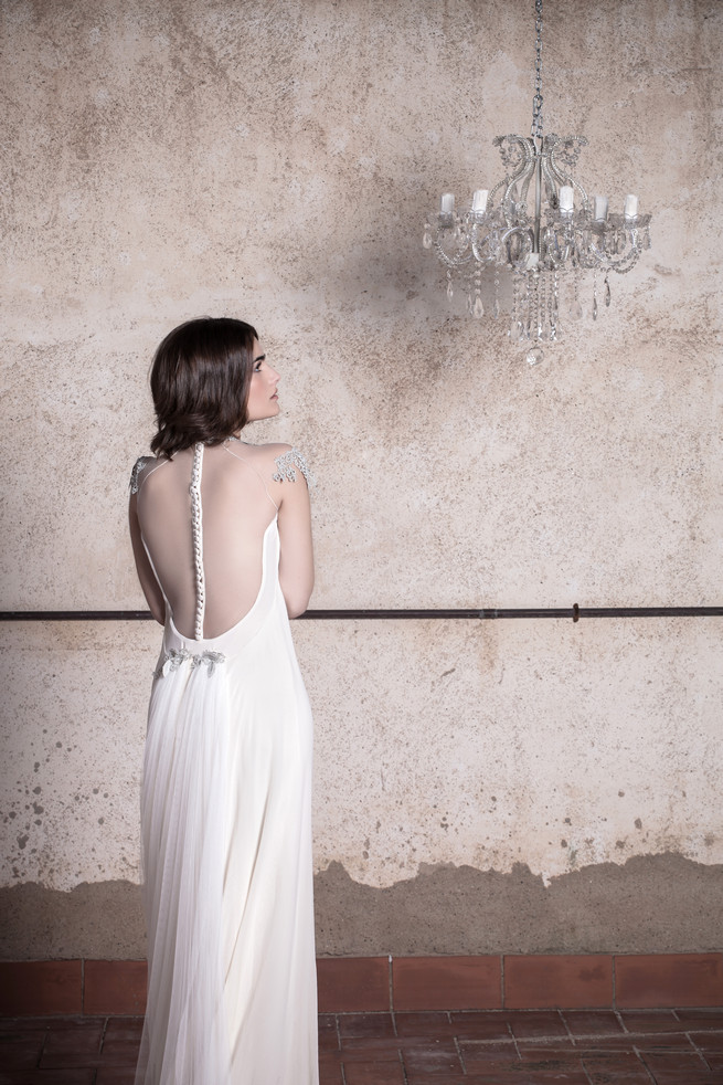 Illusion back bridal gown with  sheer embroidered chiffon cap sleeves . Ramon Herrerías Wedding Dresses