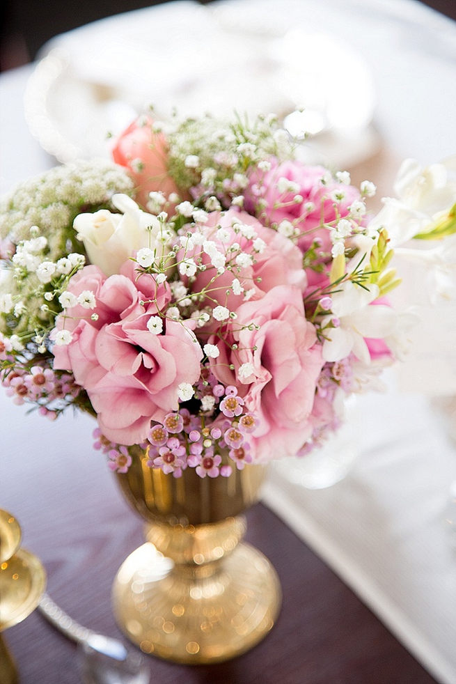 Wedding flower center piece: gold vase with babys breath, wild flowers and blush pink blooms. Soft Pink and Gold Wedding by Samanatha Jackson Photo