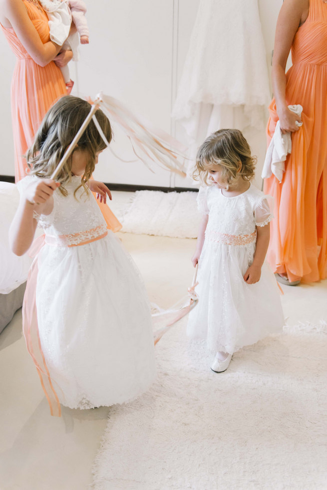Flower girls in white dresses with ribbon wands and babys breath flower crown wreaths // Succulent Garden Wedding // Claire Thomson Photography