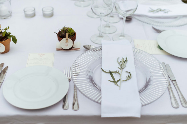 White linen, clear glass charger underplate, napkin and herb place setting with succulent favors // Succulent Garden Wedding // Claire Thomson Photography