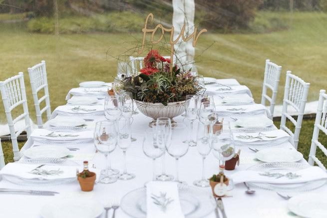 Tablescape with Succulent centerpiece arrangement with lazer cut table number // Succulent Garden Wedding // Claire Thomson Photography