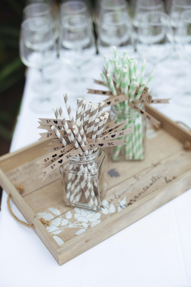 Distressed wooden tray with striped paper straws and drink flags