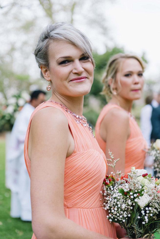 Coral bridesmaid dress // Succulent Garden Wedding // Claire Thomson Photography