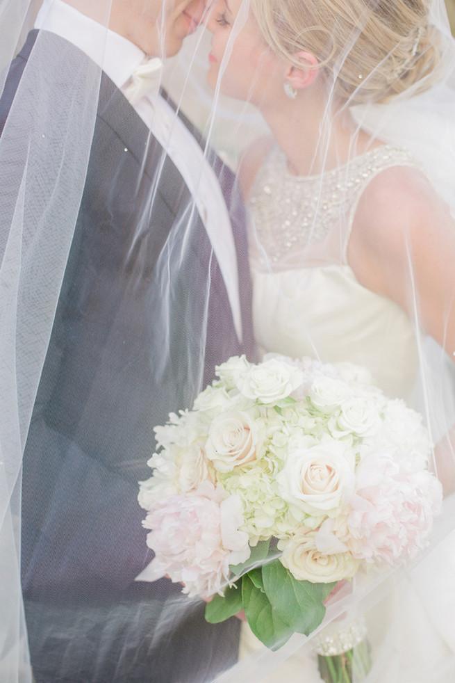 Uber romantic couple photos under a dreamy veil. Glamorous Gatsby Inspired Wedding by Elyse Hall Photography