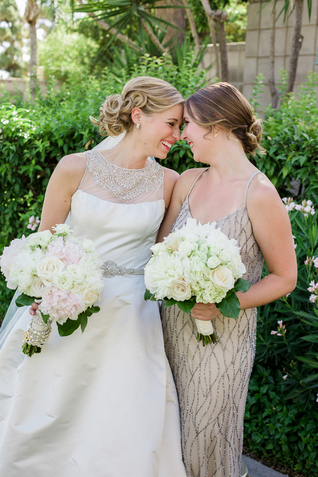 Elegant vintage style bride with champagne bridesmaids gown and white fluffy bouquets. Glamorous Gatsby Inspired Wedding by Elyse Hall Photography