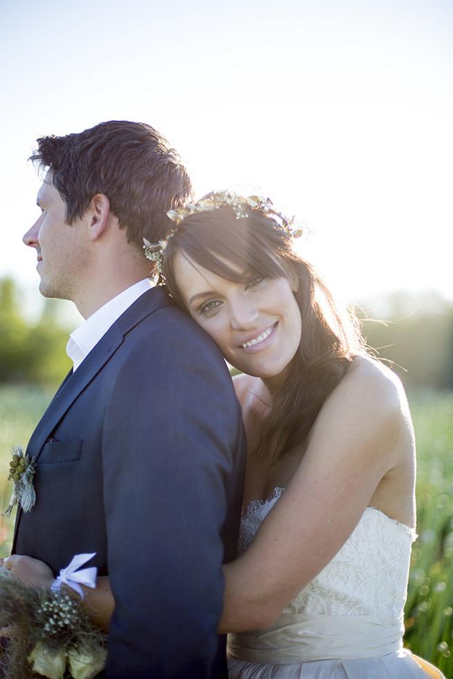 Couple wedding photographs in a field of onion flowers // Organic Farm Style Karoo Wedding // christine Le Roux Photography