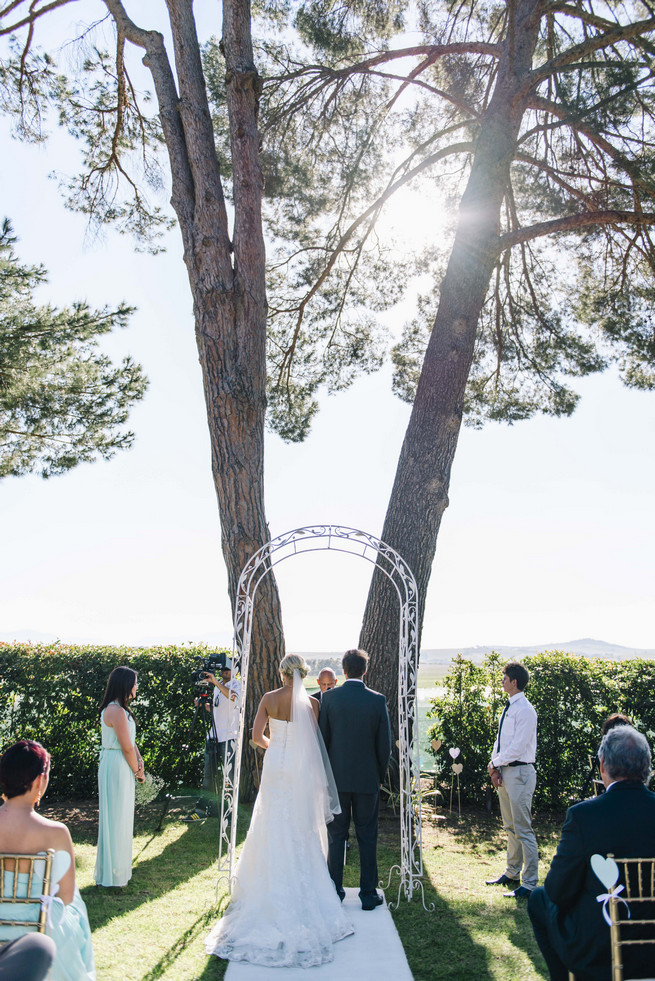 Outdoor wedding ceremony. White and Gold DIY Chevron Wedding, South Africa, by Claire Thomson Photography