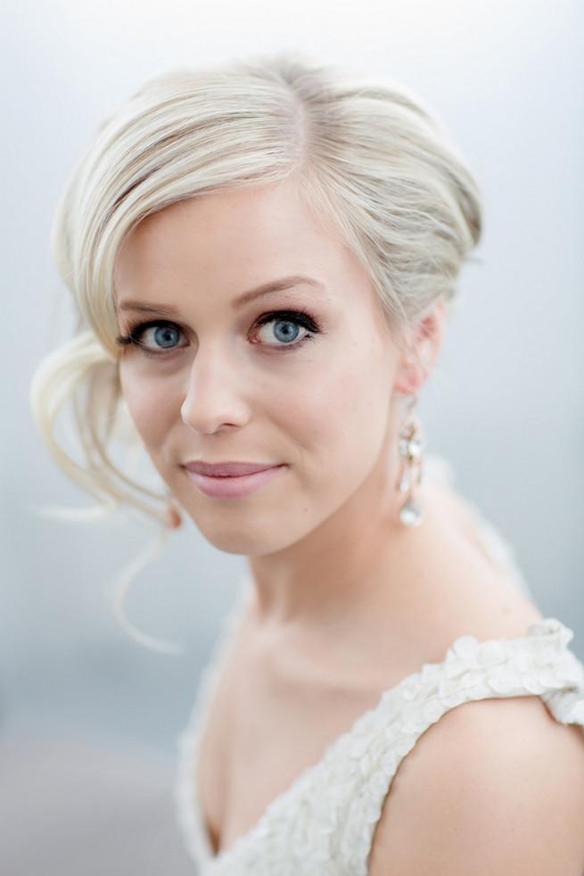 Elegant bridal upstyle with soft curls. White on White Glamorous Wedding Ideas by ENV Photography