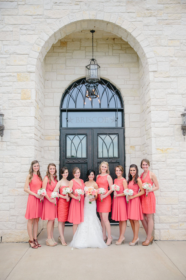 Short matching coral bridesmaid dresses with peach and white bridesmaid bouquets. Cute Coral Gray wedding at Briscoe Manor, Houston, by Luke and Cat Photography