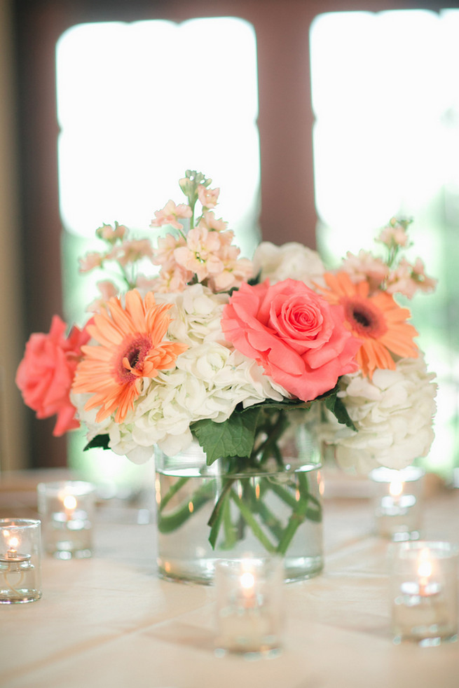 Simple but elegant. White hydrangea, coral roses and peach gerbera. Cute Coral Gray wedding at Briscoe Manor, Houston, by Luke and Cat Photography
