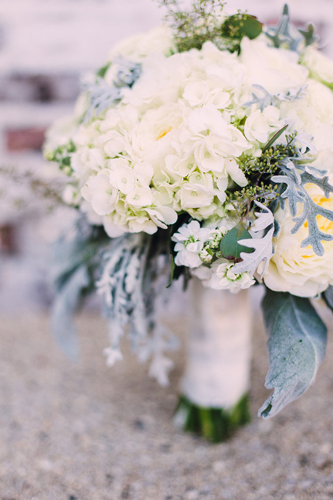 Romantic wedding bouquet of white hydrangea, white garden roeses, peony, dusty miller and lambs ear with white bouquet wrap. / Alyssa Kristin's elegant Milwaukee Wedding Valo Photography