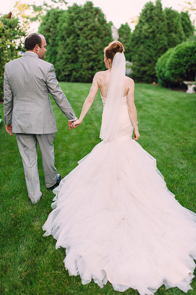 Spectacular wedding dress with seven foot train with mermaid silhouette, low back and sweetheart neckline designed by Alyssa Kristin. / Elegant Milwaukee Wedding Valo Photography