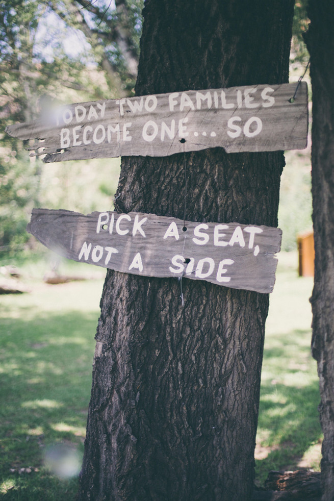 Pick a seat not a side wooden wedding sign in tree.