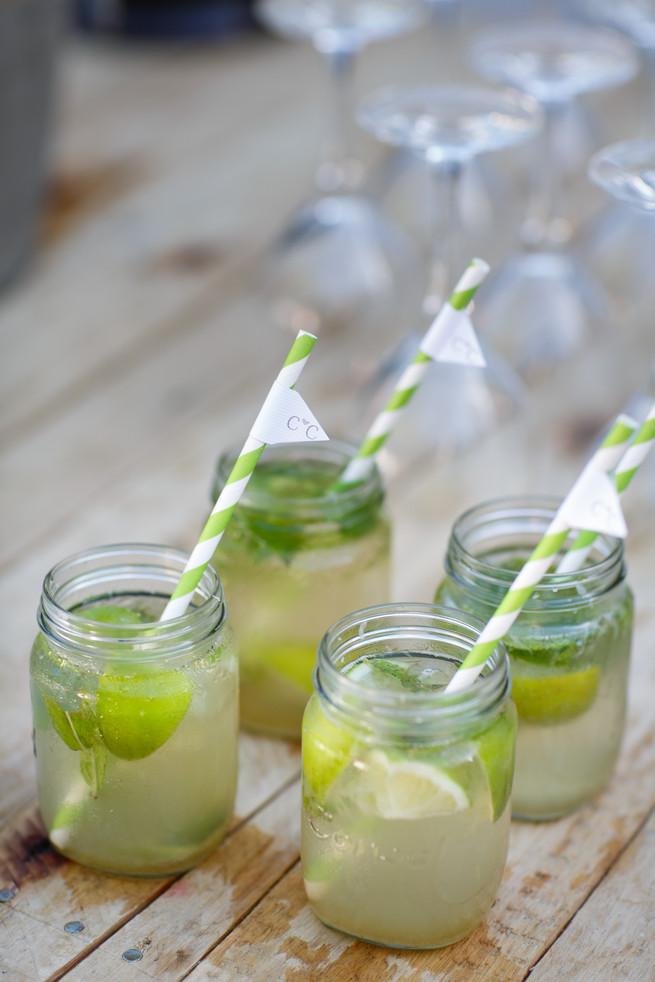 Jam / mason jars with paper straws and lemons. Pink, purple and green Natte Valleij Stellenbosch Wedding by Adene Photography