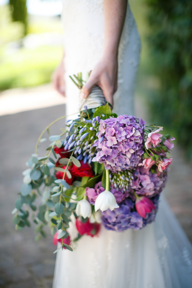Purple hydrangea, pink, red and white tulips, pink roses and eucalyptus bridal bouquet. Pink, purple and green Natte Valleij Stellenbosch Wedding by Adene Photography