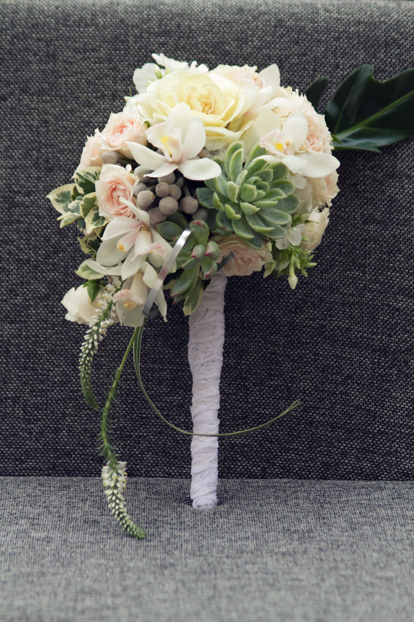 Rustic wedding bouquet with roses, echeveria succulents, grey brunia