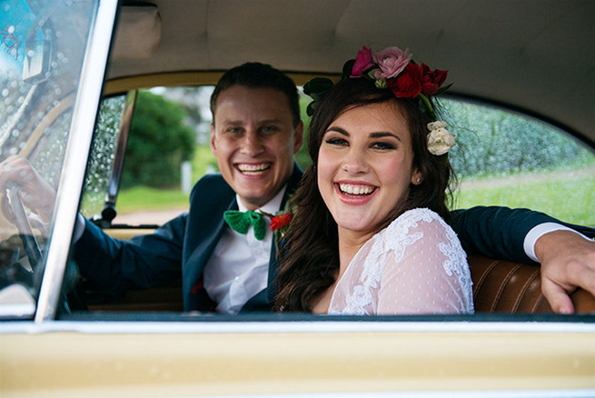 Bride and groom leaving in vintage Volkswagen Beetle. Woodlands Winter Wedding in deep blue, burgundy and emerald green // Knit Together Photography