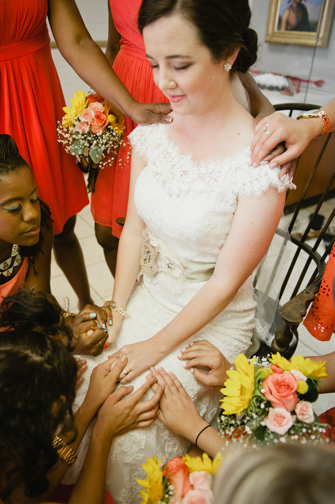 Bride praying with bridesmaids. Coral Navy Mustard Wedding / Meredith McKee Photography