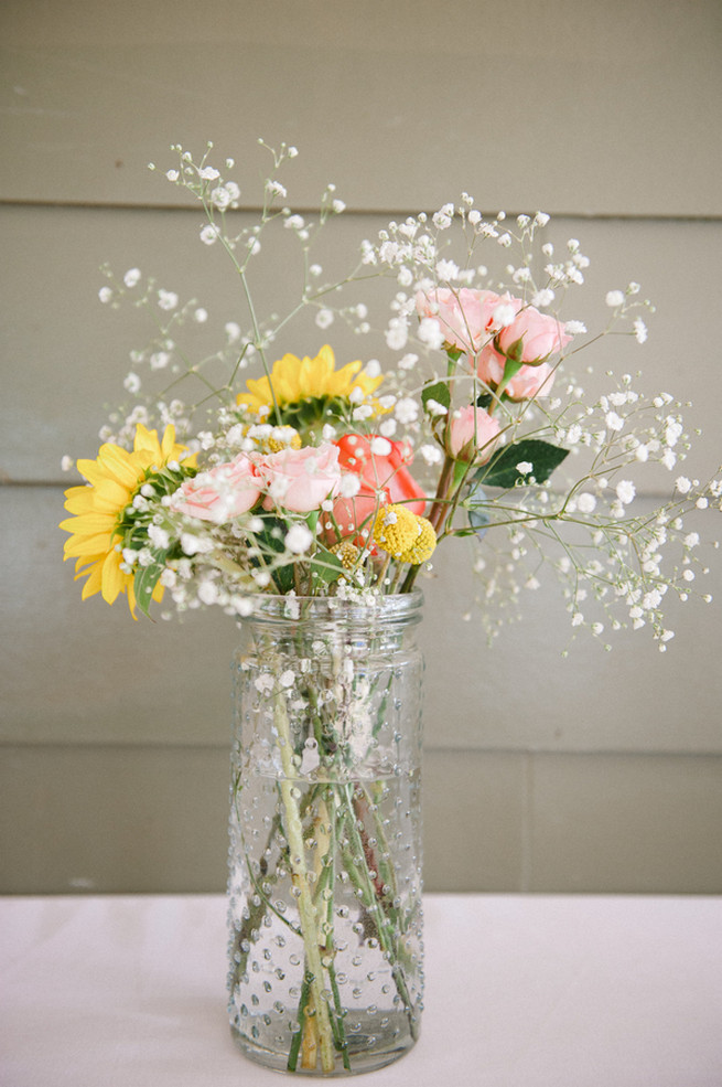 Milkbottle with sunflowers, gerberas and babys breath.  Coral Navy Mustard Wedding / Meredith McKee Photography