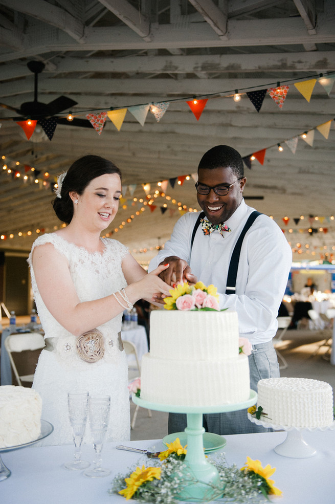 Cake cutting.  Coral Navy Mustard Wedding / Meredith McKee Photography