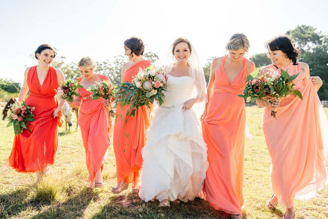 Peach coral mismatched bridesmaid dresses // Langkloof Roses Wedding, Cape Town - Claire Thomson Photography