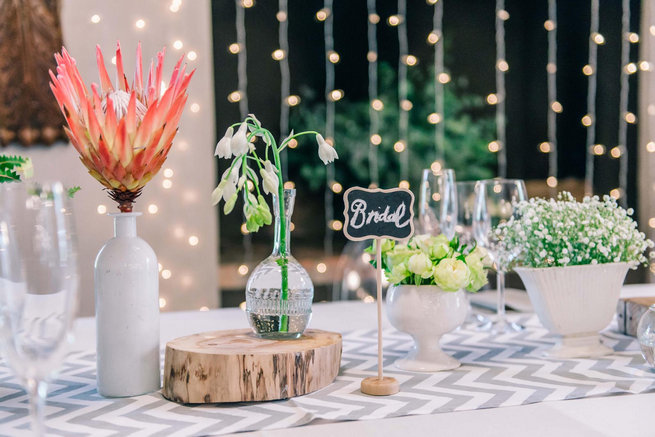 Naked bulbs and proteas with chevron runner // Langkloof Roses Wedding, Cape Town - Claire Thomson Photography