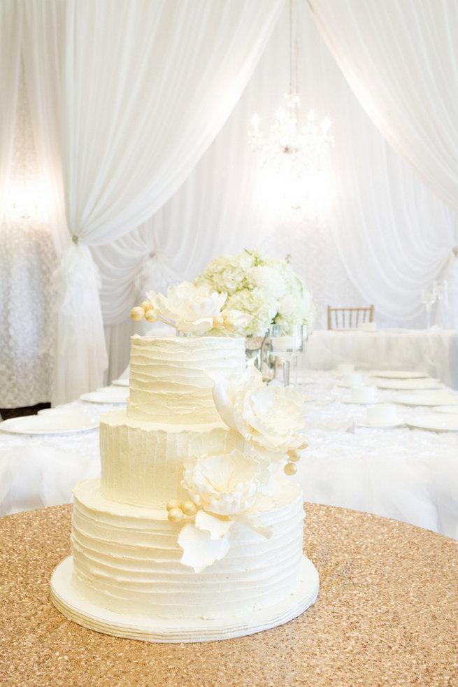 White wedding cake with white peony flowers - Vintage-Inspired White Glamorous Wedding Wedding - Haley Photography