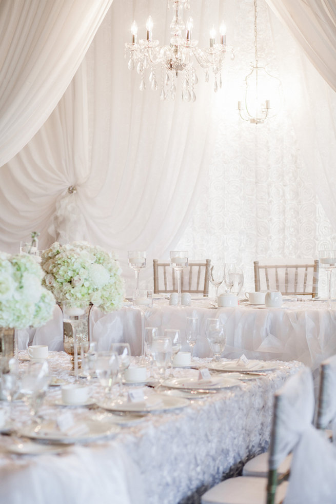 White roses and hydrangea centerpieces - Vintage-Inspired White Glamorous Wedding Wedding - Haley Photography