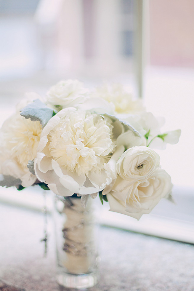 All white wedding bouquet of roses, peony, ranunculus and lambs ear