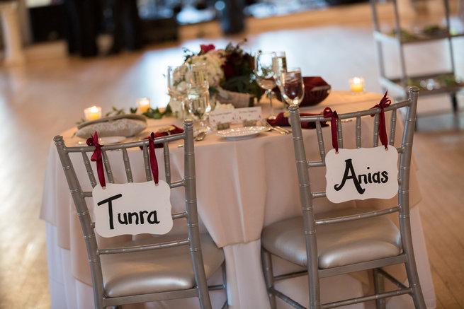 Chair signs Beautiful Burgundy and Tan Wedding - Molinski Photo