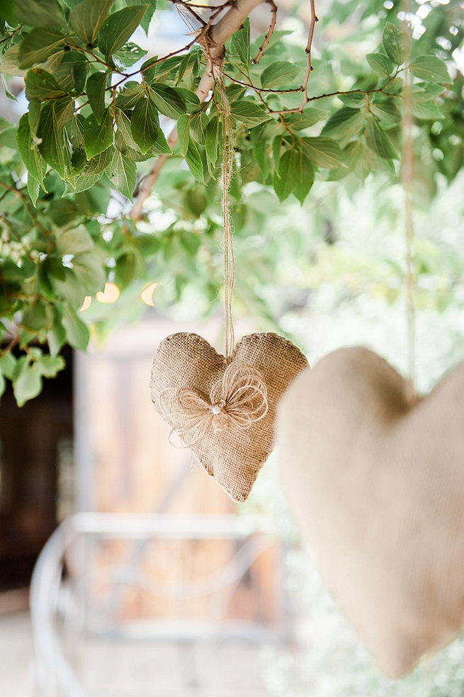 Hanging burlap wedding ceremony hearts. Coral and Green South African Wedding // D'amor Photography